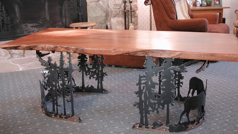 Wooden table with elk and trees metal base