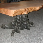 Coffee table wtih layered stump base