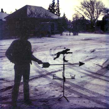 Billy McGuire posing with the very first weathervane