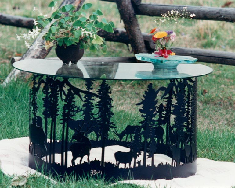 Glass table with elk and trees metal base
